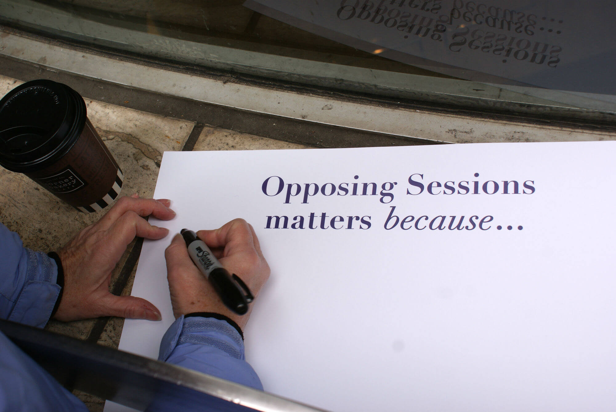 "|<image-caption></p> <p>A member of the #TuesdaysWithToomey group fills out a sign with reasons Sen. Toome|Alexis Sachdev"" title=""