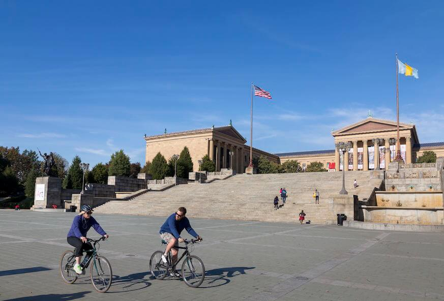 Bicyclists cruse by the Philadelphia Museum of Art. Getty Images